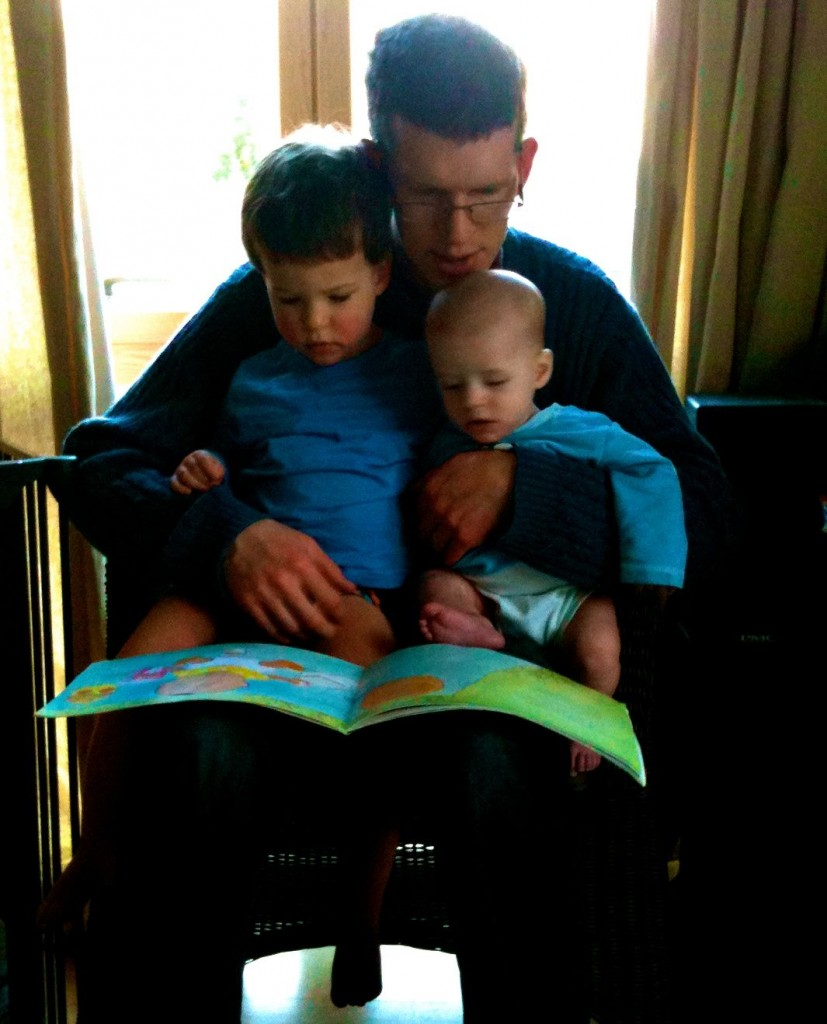 My boys reading a book at home